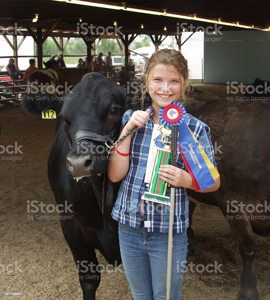 Young girl winning a competition with her cow stock photo