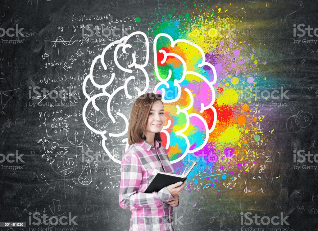 Young girl with a book and large brain stock photo