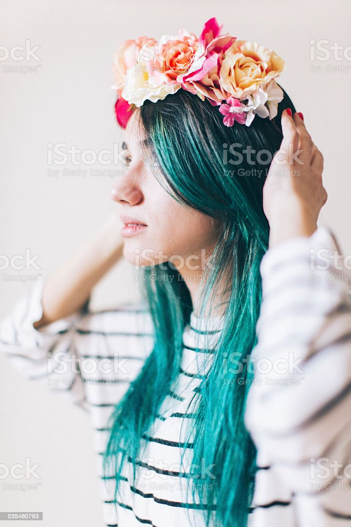 Young girl with a floral wreath stock photo