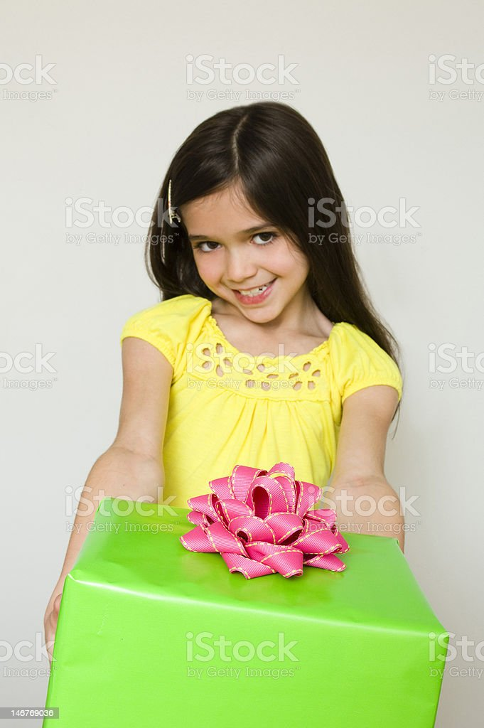Young girl with a gift. royalty-free stock photo