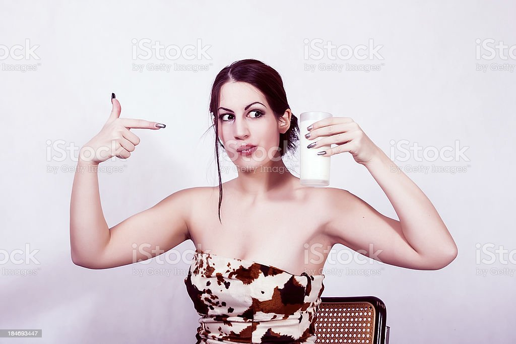 Young girl with a glass of milk royalty-free stock photo