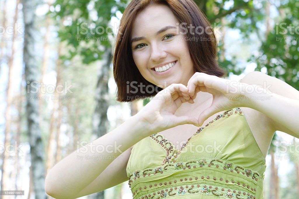 Young girl with a heart sign royalty-free stock photo