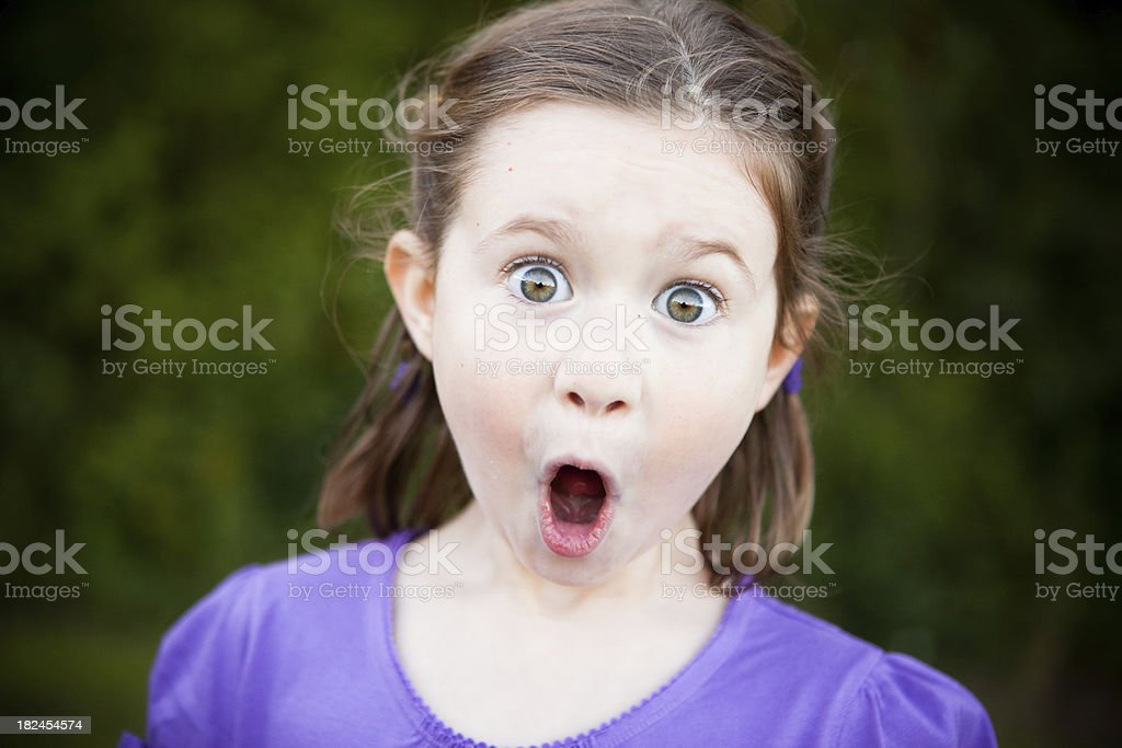 Young Girl with a Look of Surprise Outside stock photo