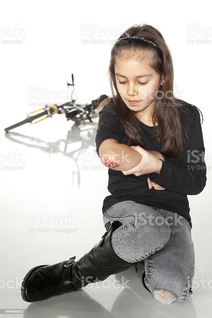 Young girl with a painful elbow on white stock photo