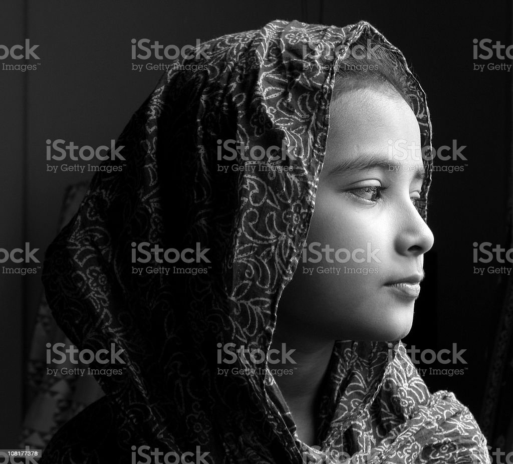 A young girl with a scarf around her head royalty-free stock photo