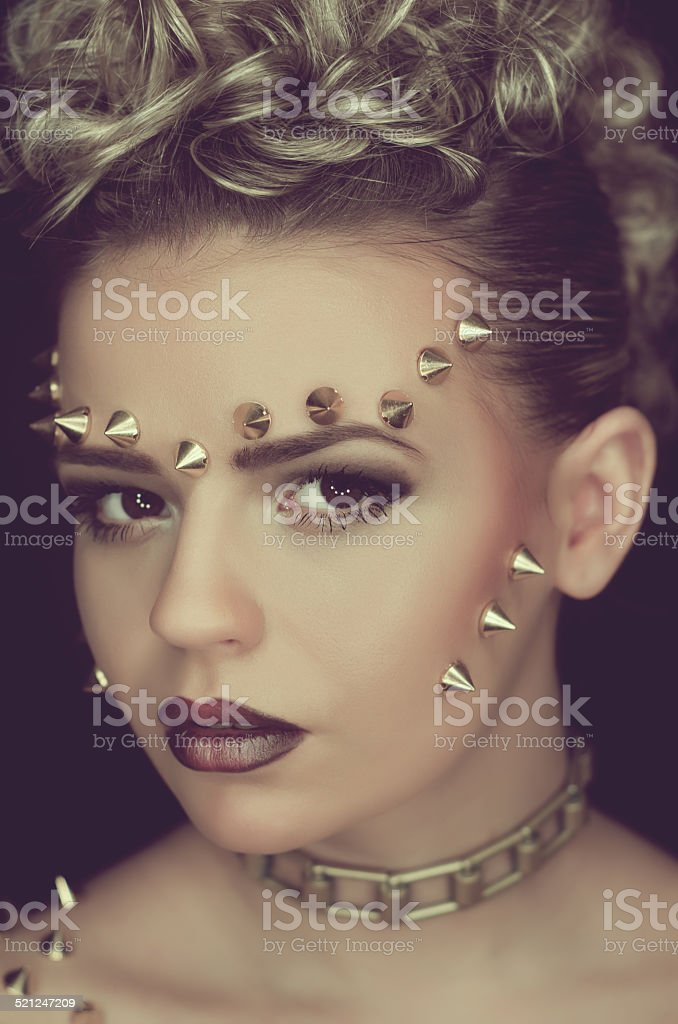 Young girl with a spiked style fashion stock photo