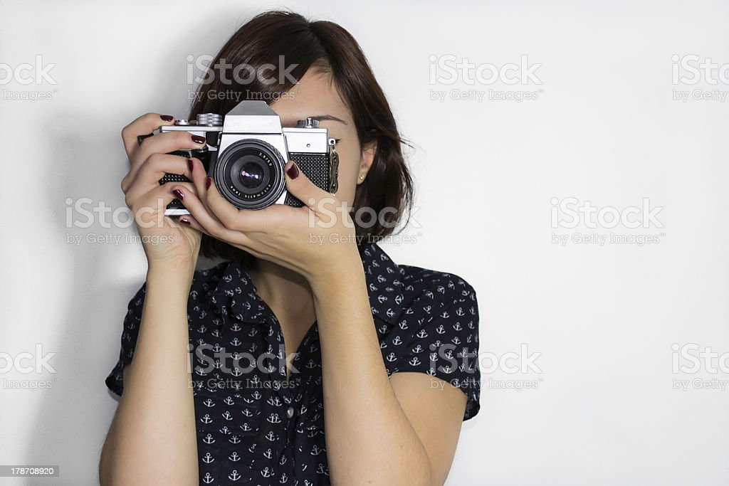 Young girl with a vintage camera stock photo