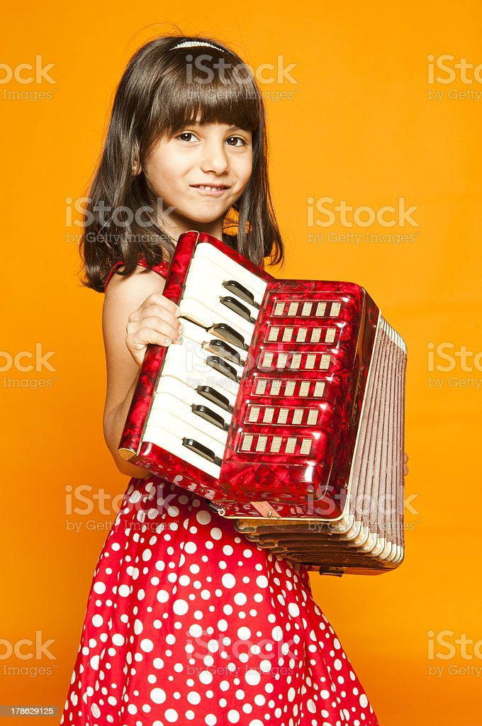 Young girl with accordion profile stock photo