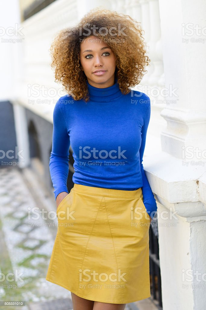 Young girl with afro hairstyle in urban background stock photo