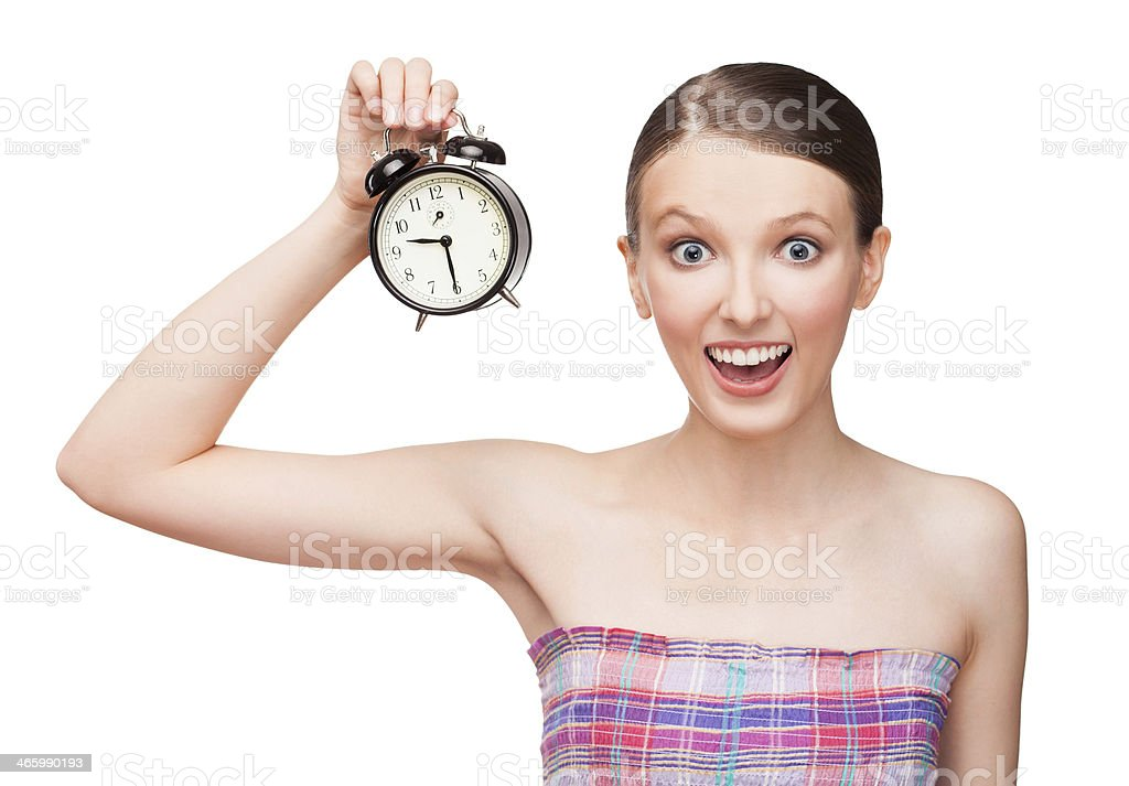 Young girl with alarm clock royalty-free stock photo