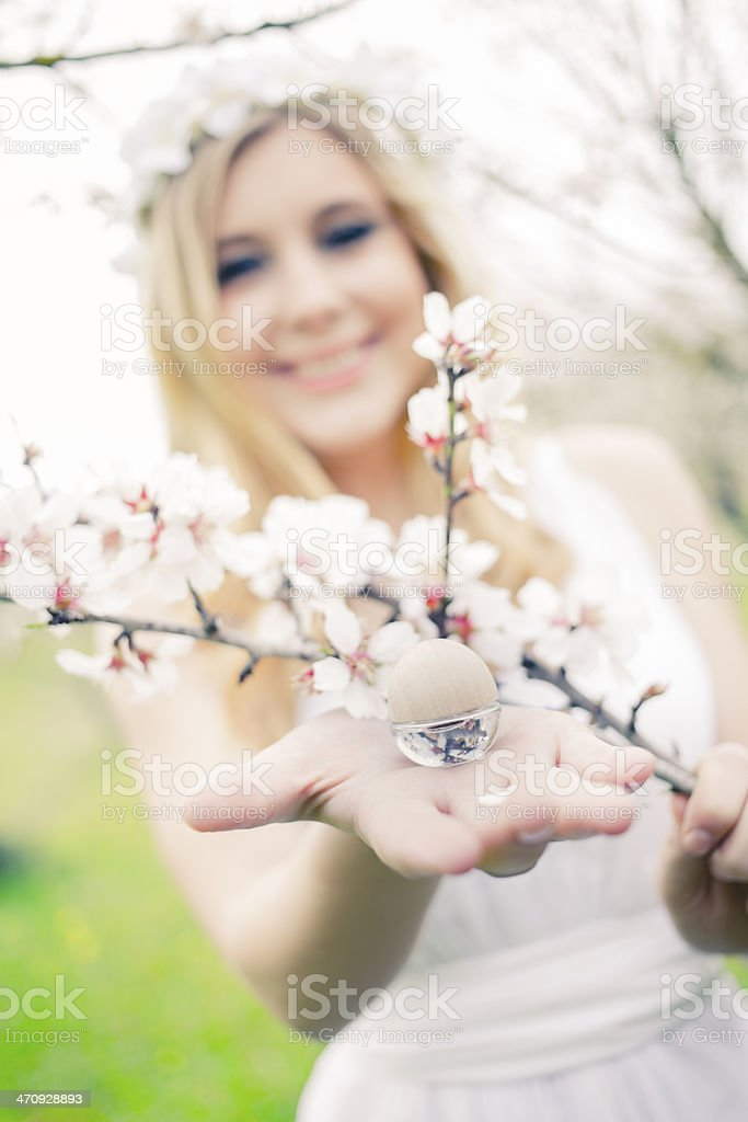 young girl with almond oil essence royalty-free stock photo