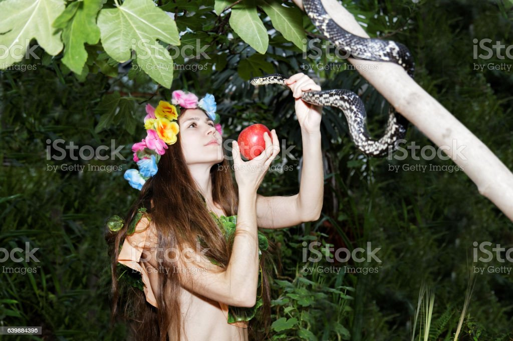 Young girl with apple and snake. Temptation of Eve. stock photo