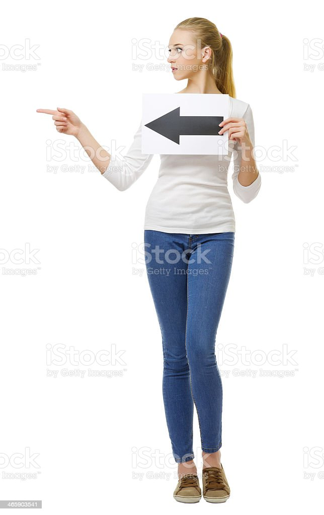 Young girl with arrow left placard stock photo