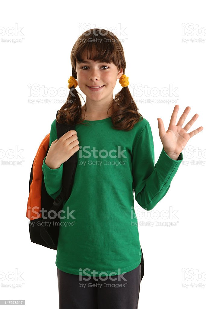 Young girl with backpack waving before going to school royalty-free stock photo
