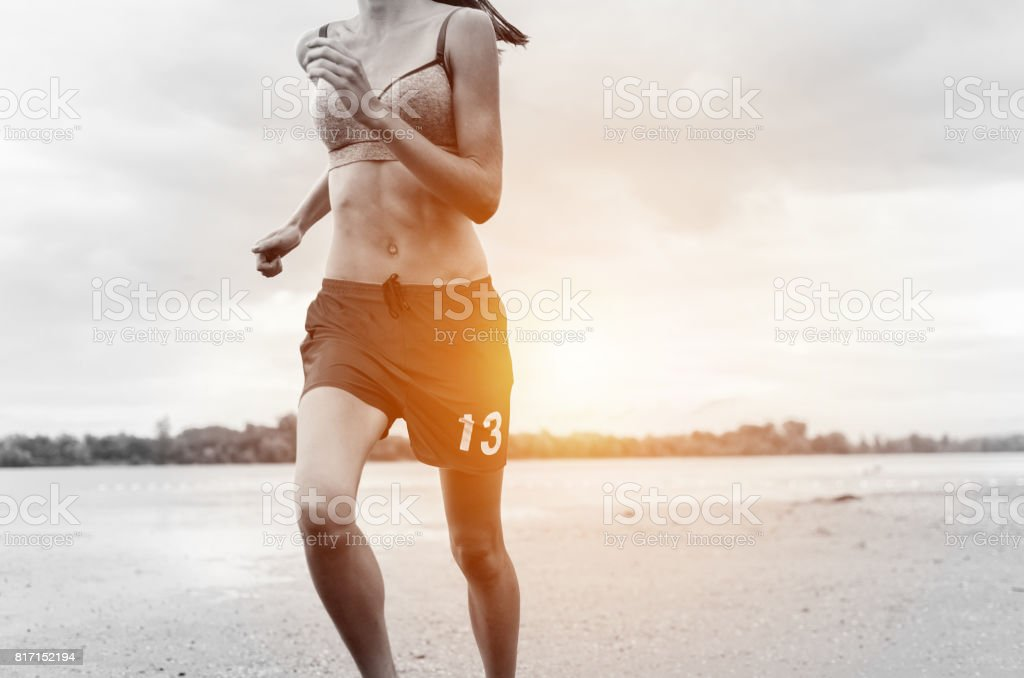 young girl with big power running and get ready for marathon stock photo