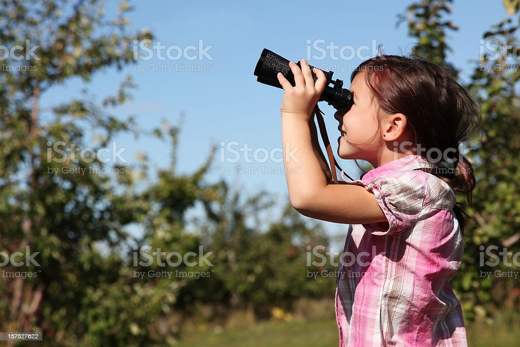 Young girl with binoculars royalty-free stock photo