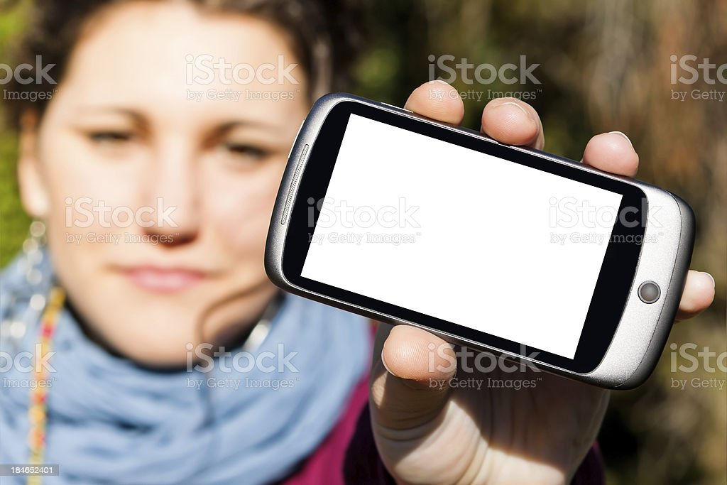 Young Girl with Blank Screen Smartphone, Exterior Shot royalty-free stock photo