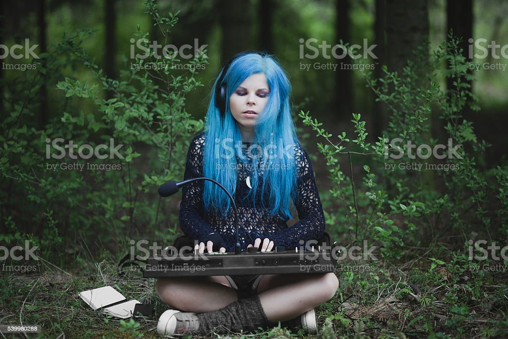 Young girl with blue hair stock photo