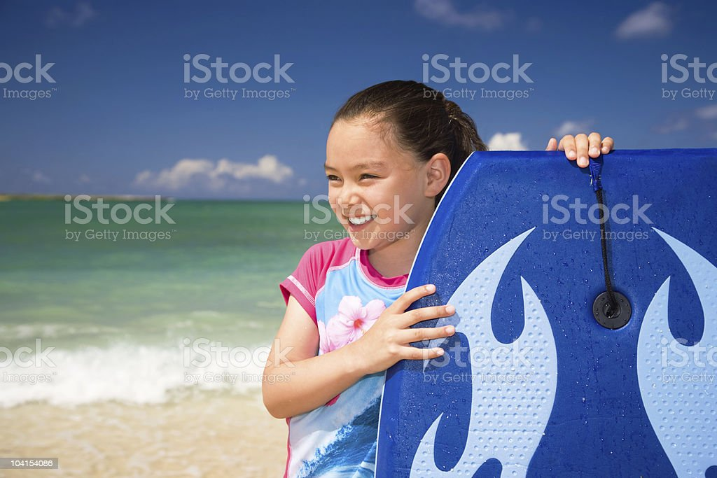 Young girl with boogie board royalty-free stock photo