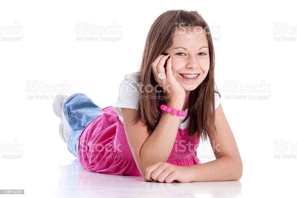Young Girl with Braces on Teeth Smiling Lying Down royalty-free stock photo