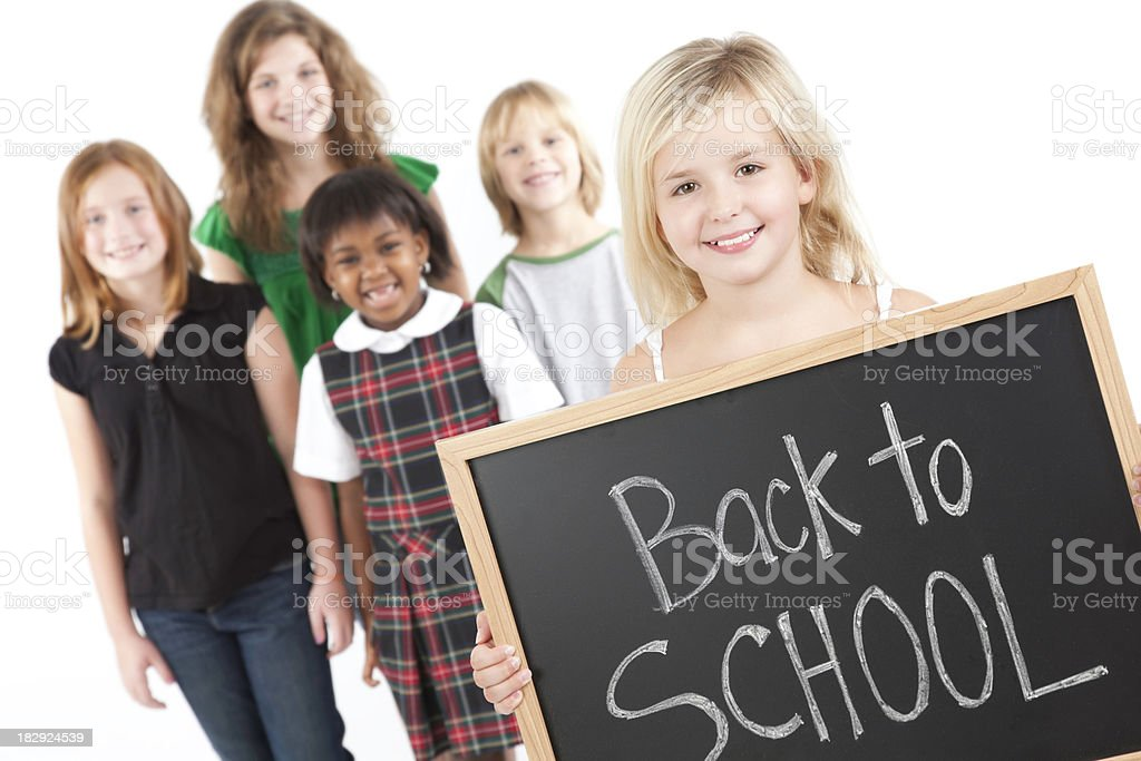 Young Girl With Classmates and Back To School on Chalkboard royalty-free stock photo