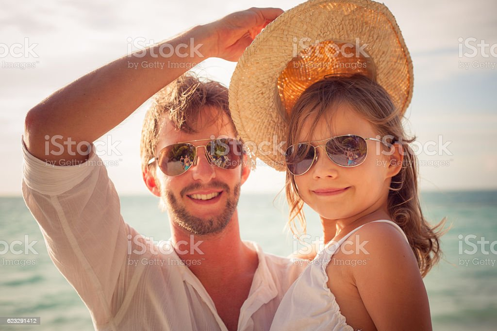 young girl with cool dad on summer day stock photo