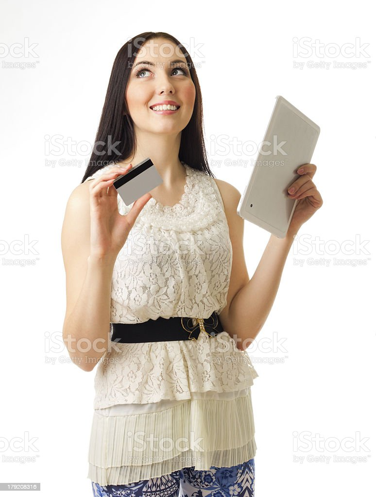 Young girl with credit card and tablet PC royalty-free stock photo