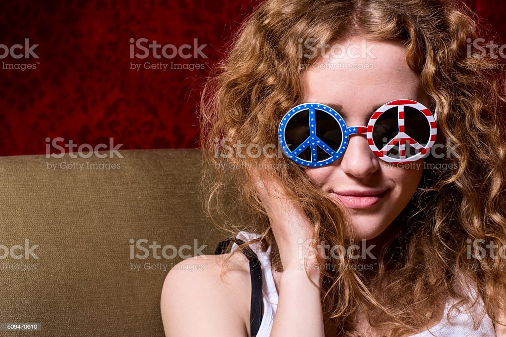 Young girl with curly hair wearing sunglasses stock photo