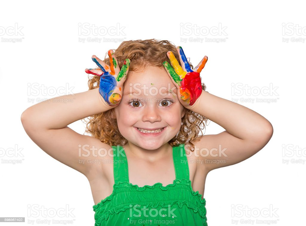 Young Girl With Curly Red Hair And Painted Hands stock photo