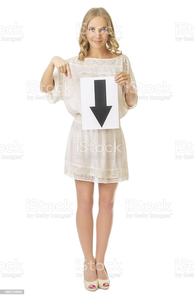 Young girl with down arrow banner stock photo