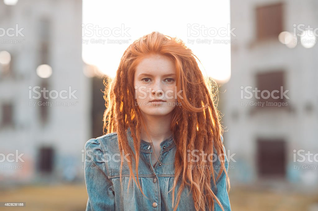 Young girl with dreadlocks outdoors stock photo