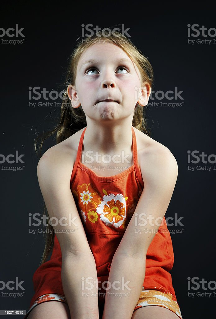 Young girl with expression of deep thought stock photo