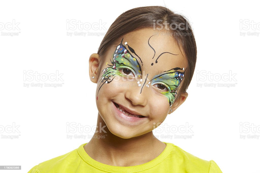 Young girl with face painting butterfly stock photo