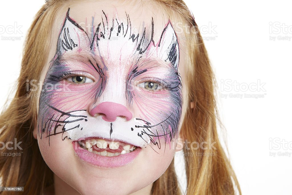Young girl with face painting cat smiling royalty-free stock photo