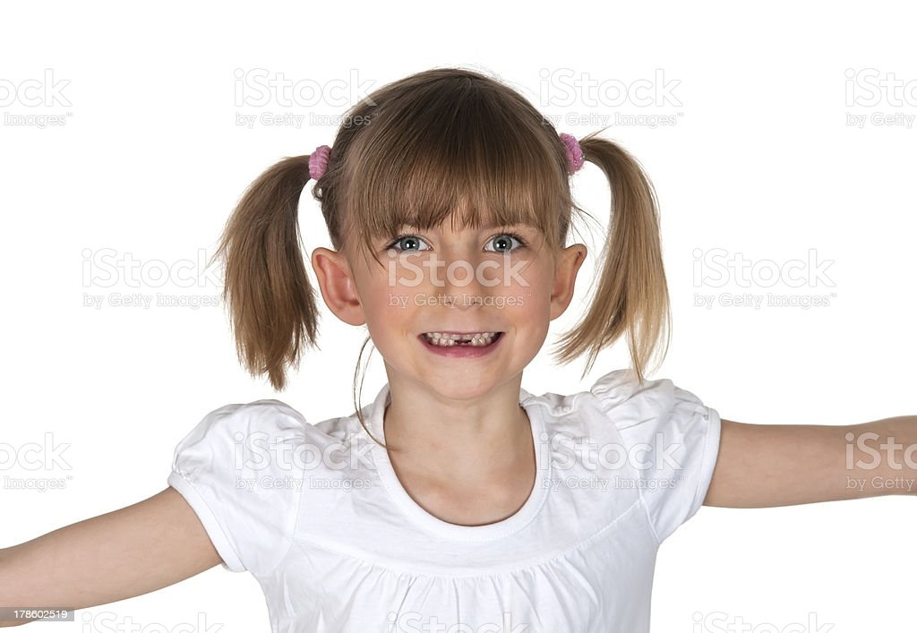 young girl with first tooth gap stock photo