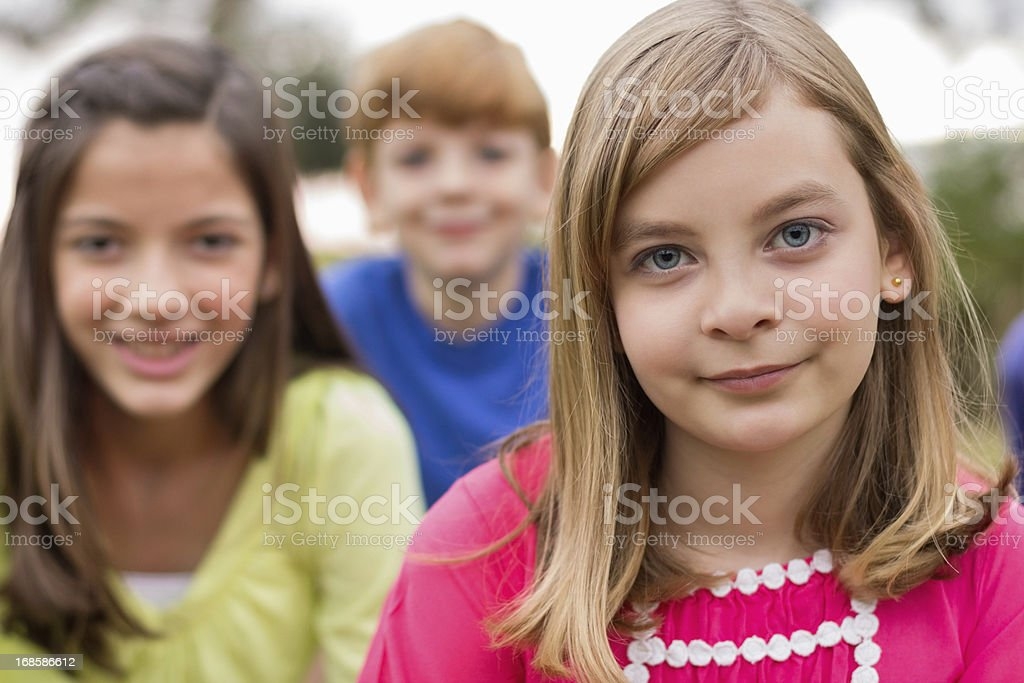Young Girl With Friends In Background royalty-free stock photo