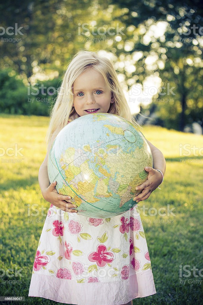 young girl with globe royalty-free stock photo