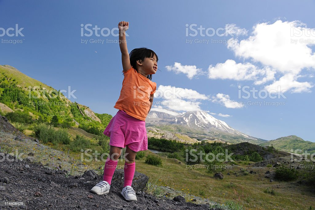 Young Girl With Hand in Air Celebrating Nature stock photo