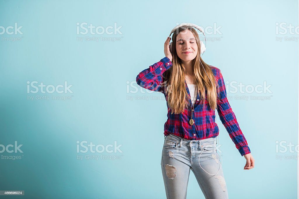 Young girl with head phones listening to music stock photo