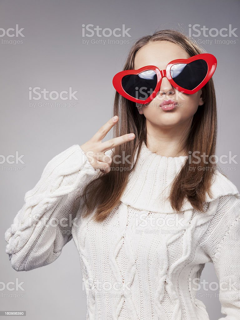 Young girl with heart shaped sunglasses royalty-free stock photo