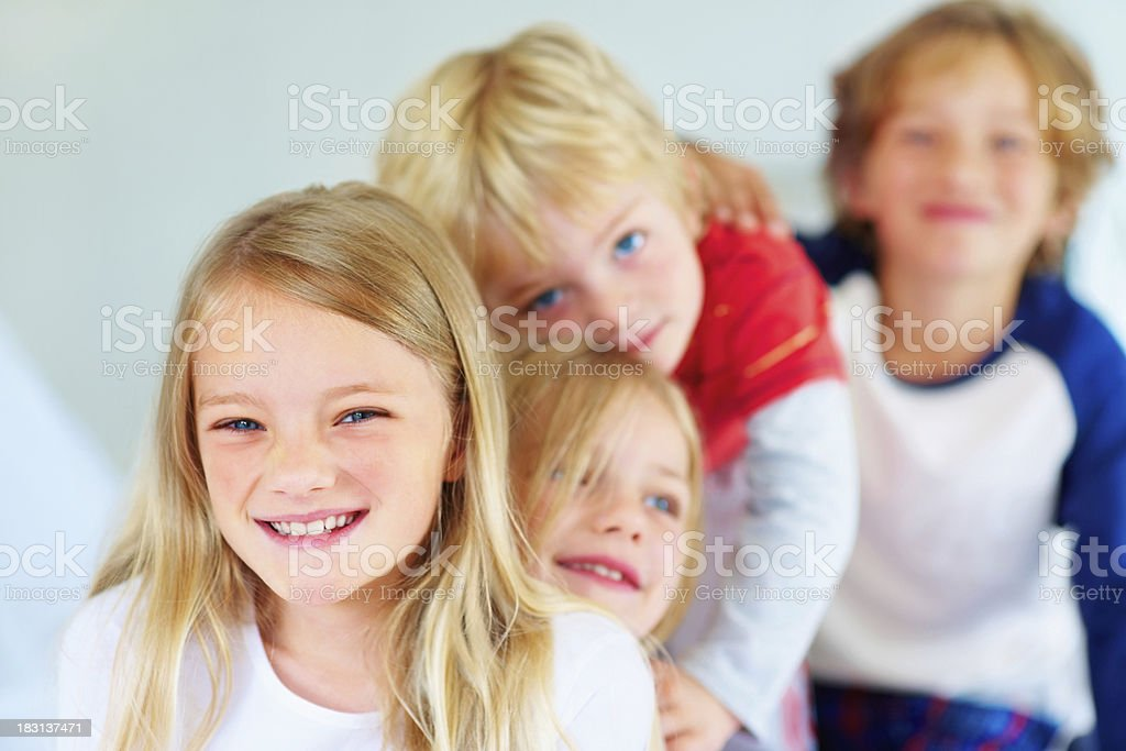Young girl with her brother and sisters standing in line royalty-free stock photo