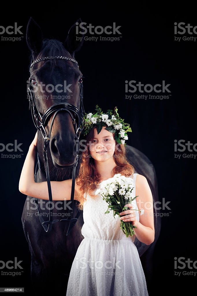 Young Girl With Her Horse stock photo