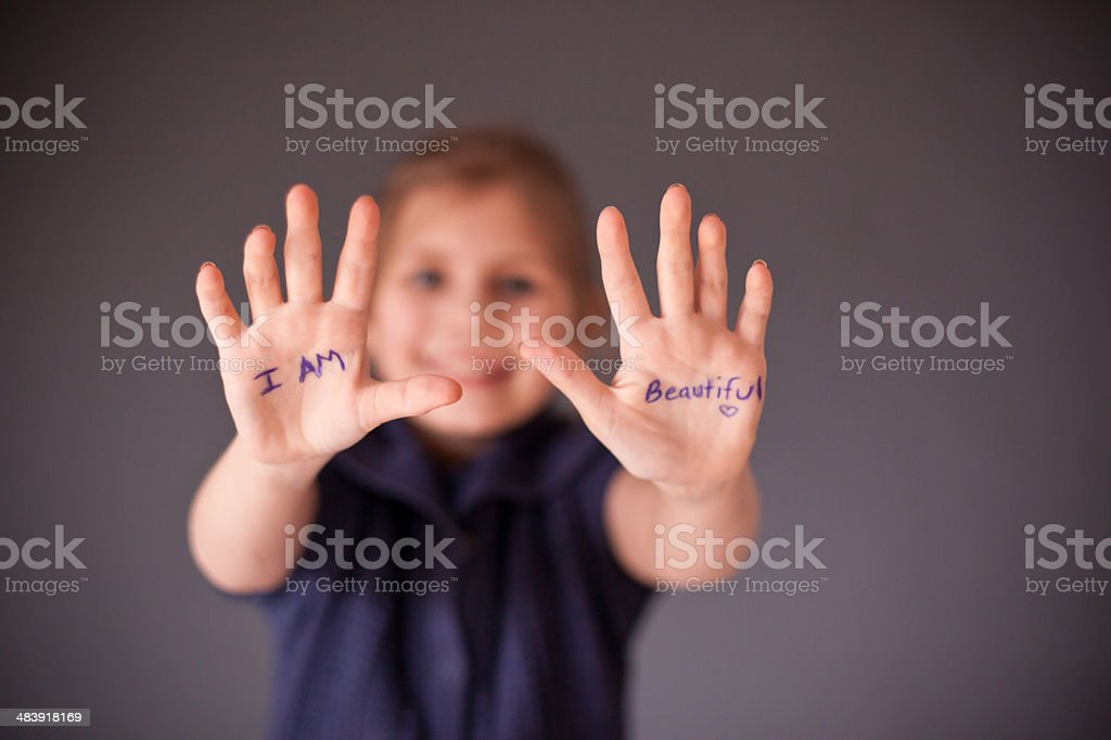 Young Girl with 'I Am Beautiful' written on her hands royalty-free stock photo