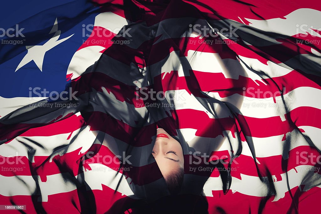 Young girl with Liberian Flag stock photo