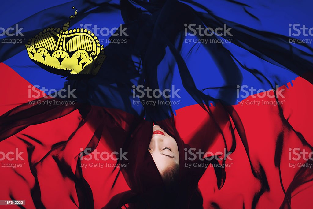 Young girl with Liechtenstein  flag stock photo
