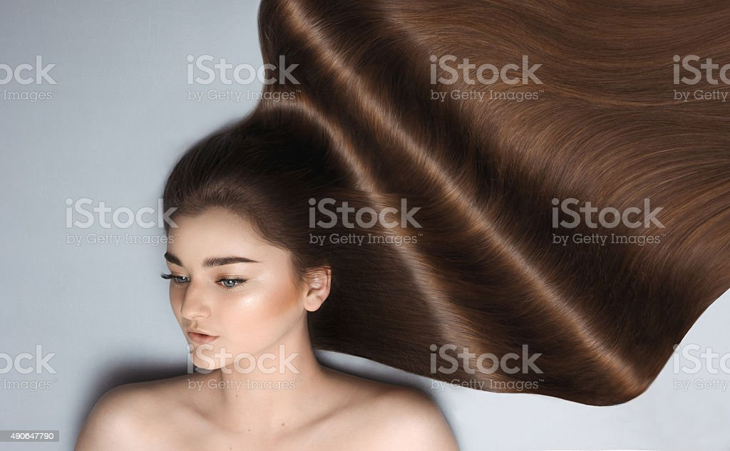 Young girl with long brown hair royalty-free stock photo