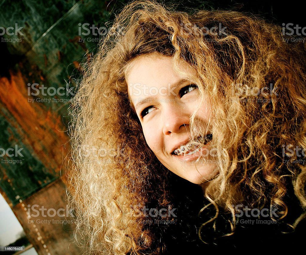 Young Girl with Long Curly Hair and Braces royalty-free stock photo