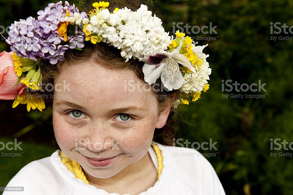 young girl with May day wreath stock photo