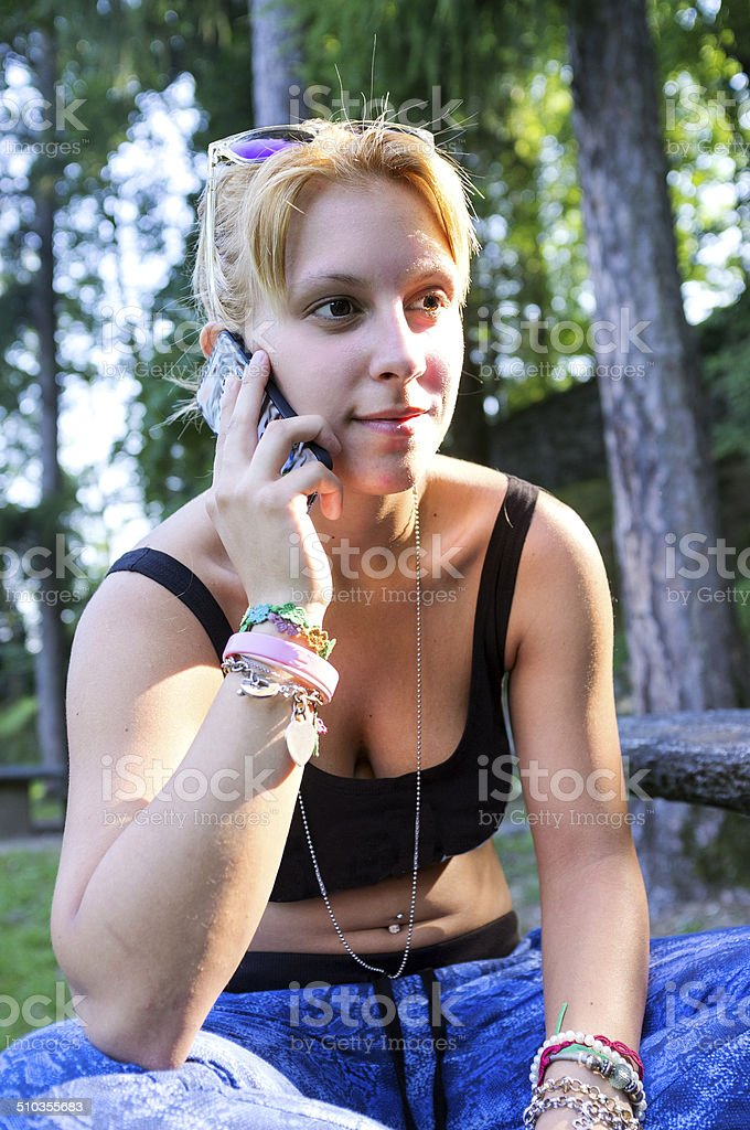 Young girl with mobile phone. Color image stock photo