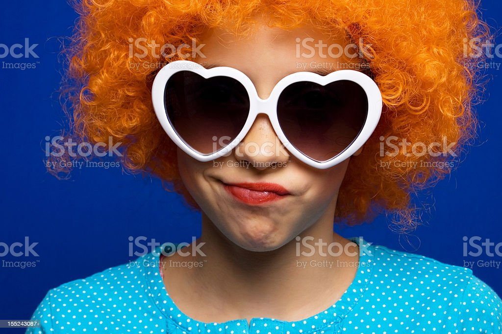 Young girl with orange party wig stock photo